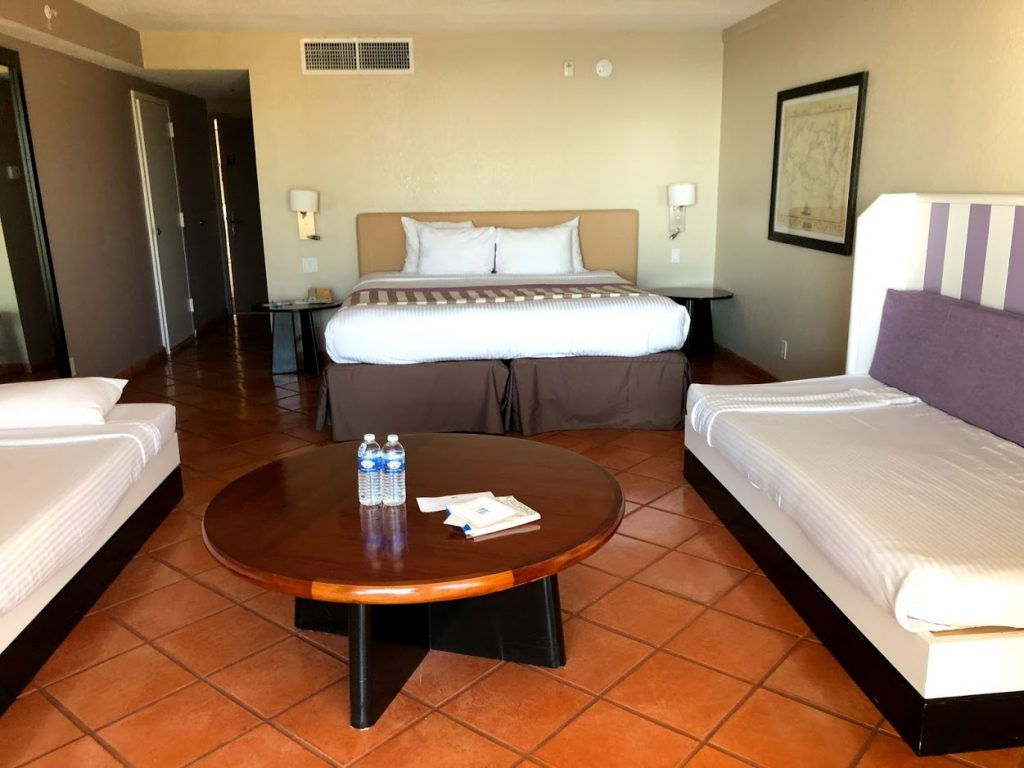 GUEST ROOM AT CLUBMED SANDPIPER FLORIDA ALL-INCLUSIVE RESORT WITH BEDS AND TABLES