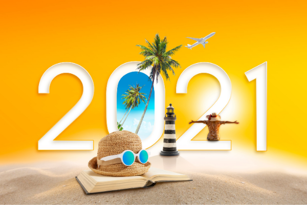 2021 travel planning with airplane, book, sunglasses and palm trees