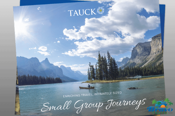 a brochure cover from Tauck tours with some lake and mountain scenery